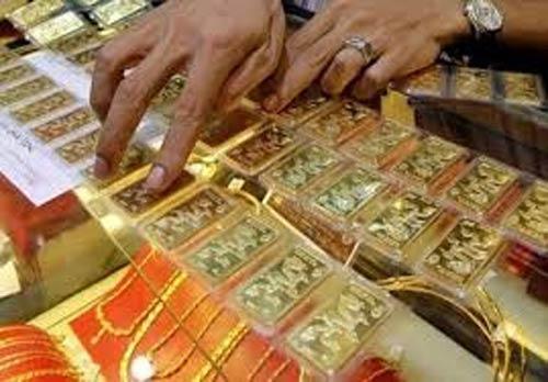 Mua gom hơn 100 tấn vàng trong dân - 1