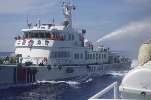 Trung Quốc kêu gọi kết cục hòa bình ở biển Đông - 1
