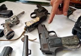 Cán bộ công an đột nhập kho vũ khí lấy trộm 5 khẩu súng - 1
