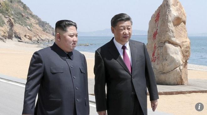 Vì sao Kim Jong-un đột nhiên sang Trung Quốc gặp ông Tập bên bờ biển? - 1