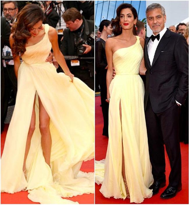 Amal Clooney có lẽ ước mình nên chọn bộ váy xẻ thấp hơn bởi chiếc đầm này khiến cô lúng túng thực sự.