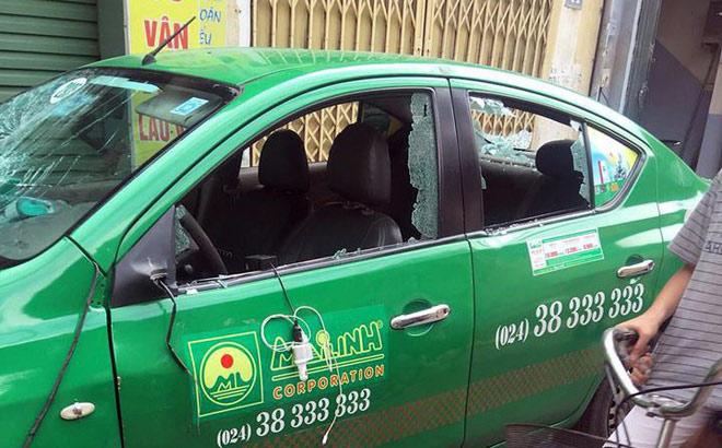 Danh tính người vác gậy sắt đập vỡ toang kính ôtô taxi Mai Linh - 1