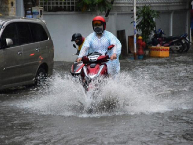 Miền Bắc oi nóng, miền Nam mưa xối xả, đề phòng ngập lụt