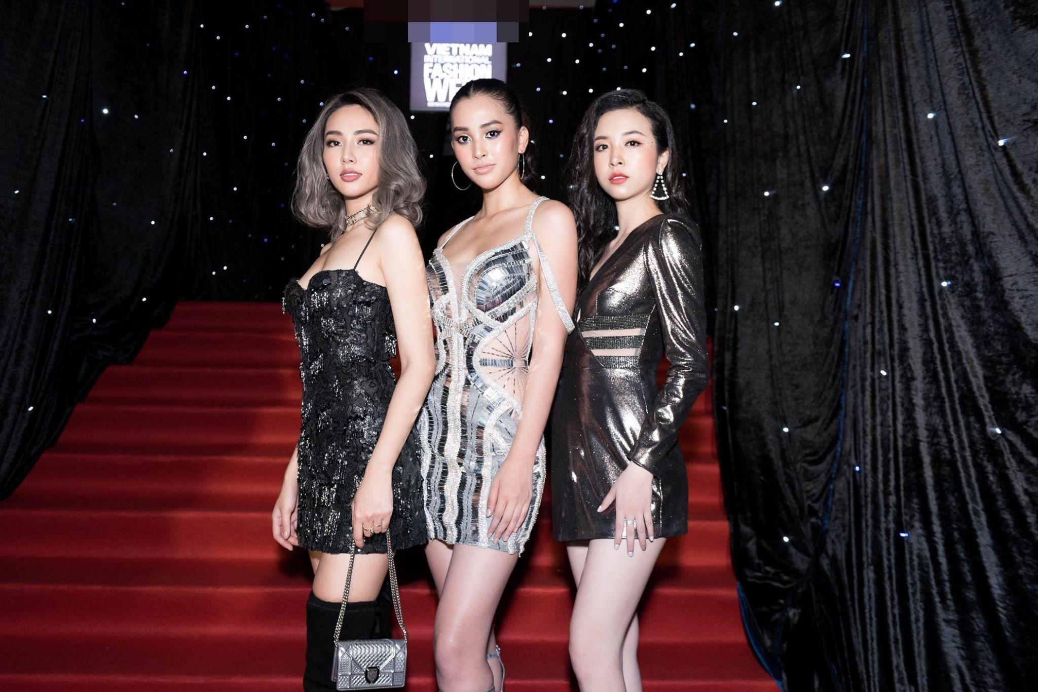 Tiểu Vy diện váy khoét eo, trang điểm lạ mắt tại Tuần lễ thời trang - 1