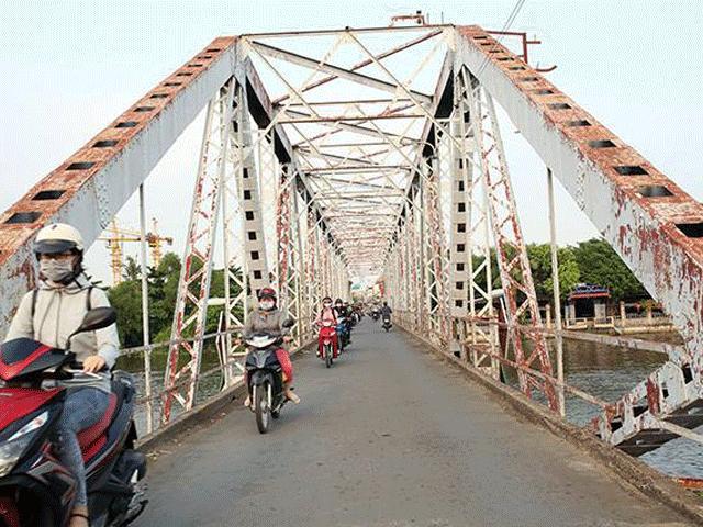 Ngắm cây cầu cấu trúc thép Eiffel hơn 100 tuổi nối đôi bờ sông Sài Gòn đang bị khai tử