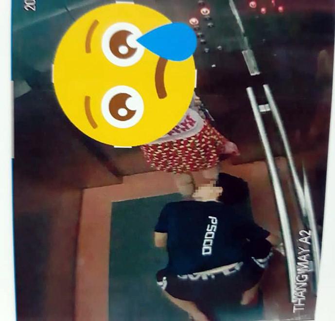 Phát hoảng với hình ảnh thanh niên quỳ gối nhìn vào váy cô gái trong thang máy - 1