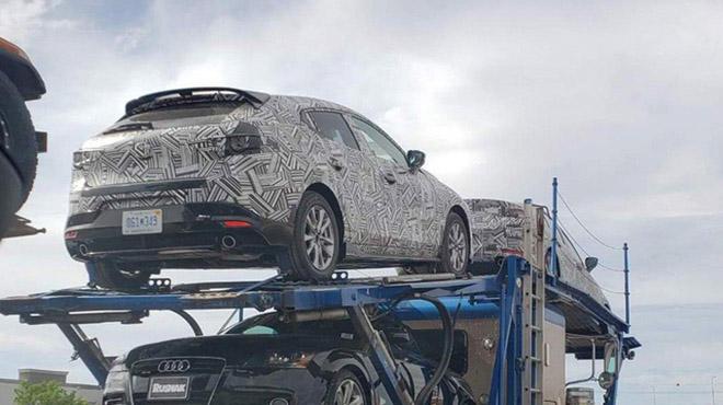 Mazda 3 phiên bản hiệu xuất cao được nguy trang cẩn thận bị bắt gặp đang trên đường vận chuyển - 1