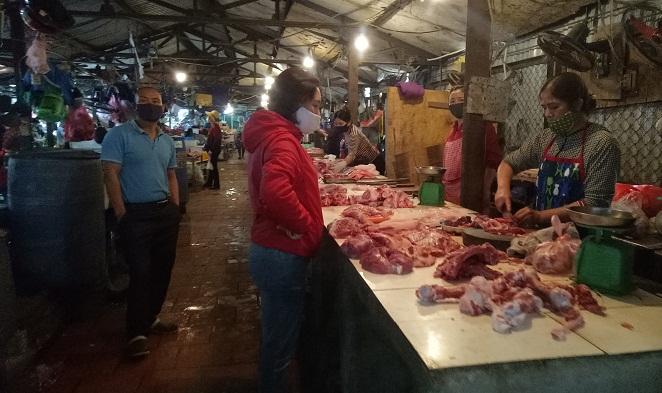 Sau chỉ thị giảm giá từ 1/4, giá thịt lợn có hạ nhiệt? - 1
