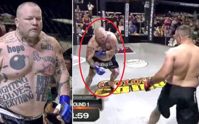 """""""Quái vật khóa chân"""" xăm trổ kín người thua ở trận đấu kỳ lạ nhất MMA - 1"""