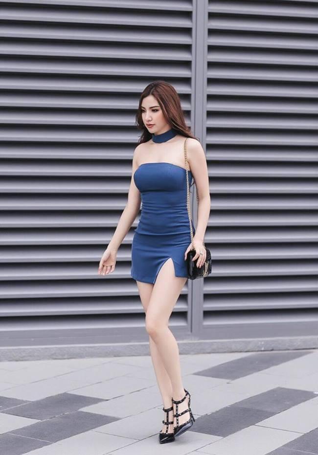 Thân hình chuẩn mẫu của người đẹp Hà thành được cô khoe trong loạt trang phục tôn dáng.