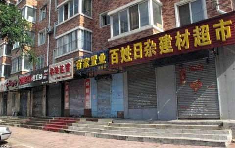 TQ: Cả thành phố ngừng buôn bán vì tin đồn - 1