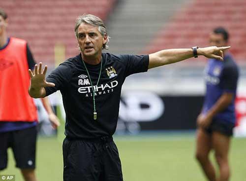 Mancini bất ngờ dọa rời Man City - 1