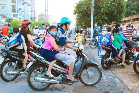 TPHCM: Từ 12/9, bắt buộc đội MBH cho trẻ em - 1