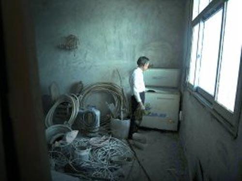 TQ: Ướp xác con 6 năm trong tủ đá - 1