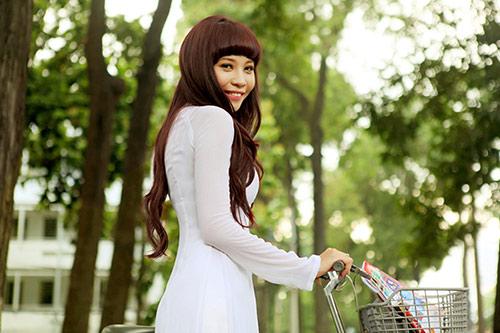 Đàm Thu Trang tinh khôi áo dài trắng - 1