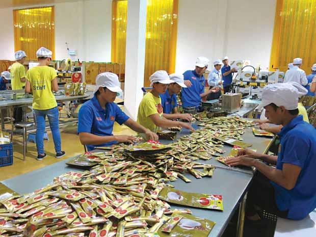 Nữ tỉ phú người Việt trên đất Lào - 1
