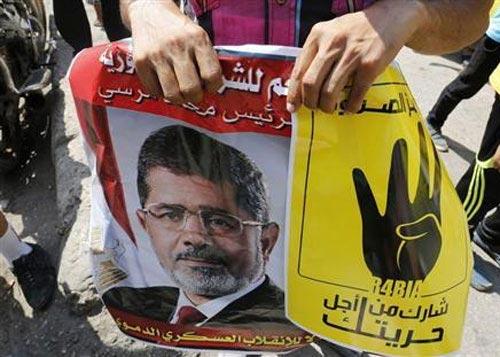 """Ai Cập xử ông Morsi vì """"kích động giết người"""" - 1"""