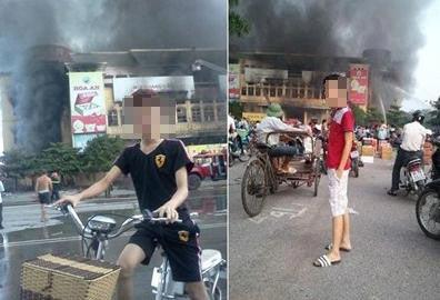 2 thanh niên tạo dáng trước đám cháy gây bất bình - 1