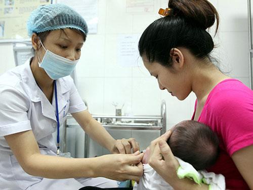 Bồi thường 30 lần lương cơ bản cho người tai biến do tiêm vắc-xin - 1