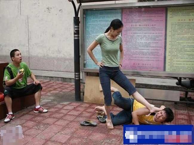 Asian girl kicks man to head