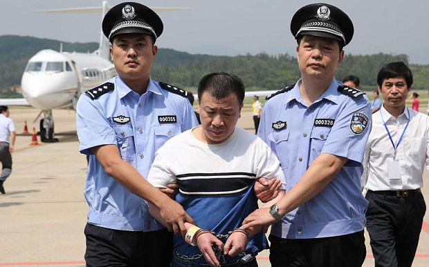 Mỹ trao trả nghi phạm tham nhũng cho Trung Quốc - 1