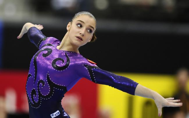 Aliya Mustafina 21 tuổi, VĐV thể dục dụng cụ, Nga đã từng giành được những thành tích ấn tượng, nổi bật là tấm huy chương vàng nội dung xà lệch tại Olympic London.