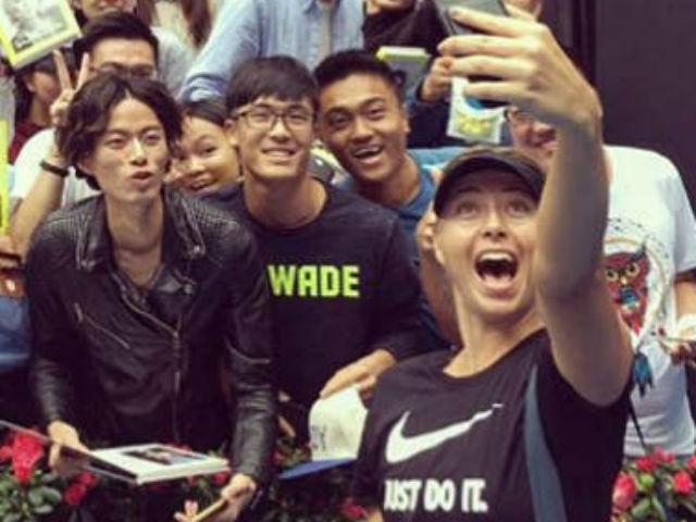 """Mỹ nhân Sharapova tới Trung Quốc: Triệu fan nam phát cuồng """"ăn chực nằm chờ"""""""