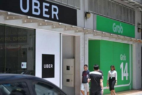 Thương vụ Grab mua Uber có thể bị hủy bỏ, Grab đối mặt với án phạt tài chính - 1