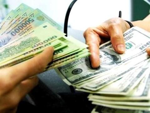 Vì sao Ngân hàng Nhà nước tăng giá bán USD? - 1