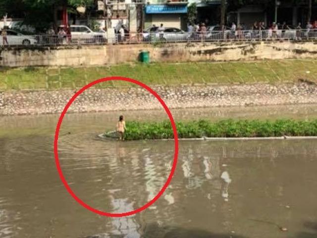 Tin mới vụ cô gái trẻ cởi đồ bơi ra giữa sông Tô Lịch nhảy múa