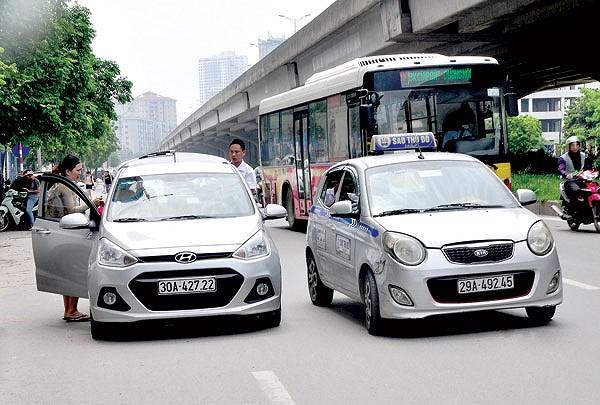 Taxi truyền thống, Grab muốn kiếm tiền, phải đổi màu biển số? - 1