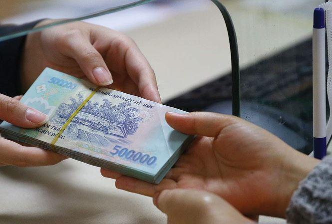 Thắt tiền tệ, tín dụng tăng thấp nhất 3 năm qua - 1