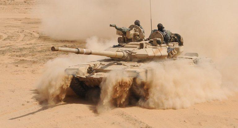 Quân đội Syria giáng đòn sấm sét, IS vùi thây trong sa mạc - 1