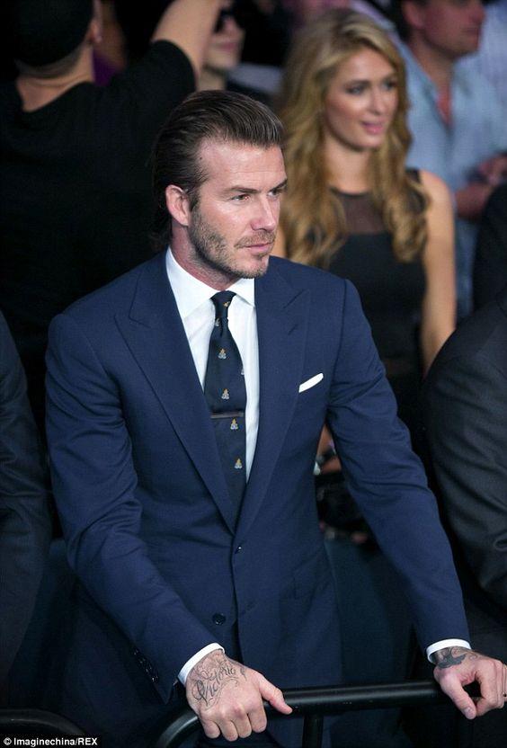 Vì sao David Beckham thường không bao giờ cài cúc cuối của bộ suit? - 1