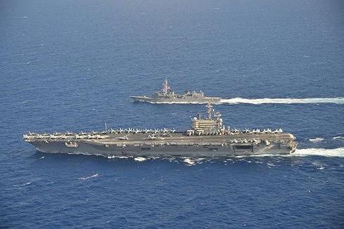 Việt Nam lên tiếng về việc tàu sân bay Mỹ tiến vào Biển Đông - 1