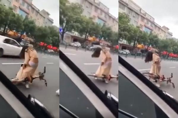 Cô gái gặp sự cố váy dài giữa phố và trào lưu mặc điệu, đạp xe - 1