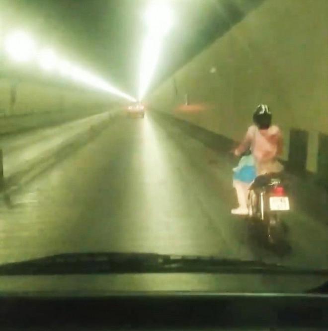Xác minh danh tính nữ tài xế xe máy vượt biển cấm xuyên hầm Hải Vân - 1