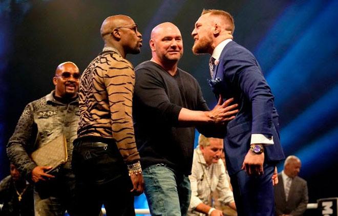 """""""Bố già"""" tiết lộ Mayweather sắp đấu UFC, McGregor bắn tín hiệu trở lại - 1"""