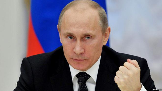"""Putin """"phản đòn"""" đầy bất ngờ sau khi Obama trừng phạt Nga - 1"""