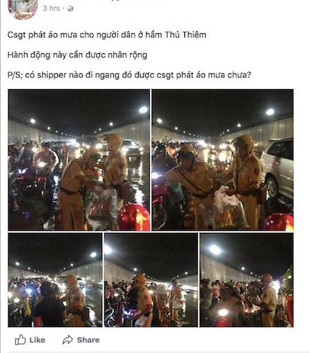 """Dân mạng chia sẻ """"rần rần"""" ảnh CSGT phát áo mưa trong đêm Trung thu - 1"""