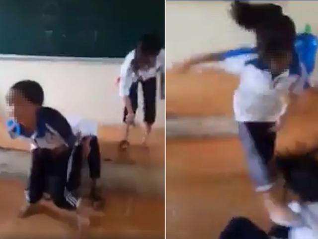 Nữ sinh cấp 2 bị bạn đánh dã man, xé áo hở cả nội y trên bục giảng