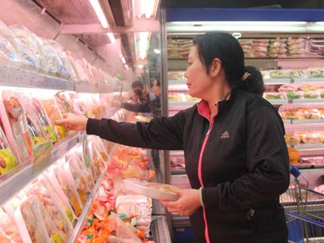 Đùi gà Mỹ nhập về Việt Nam… 2.000 đồng/kg? - 1