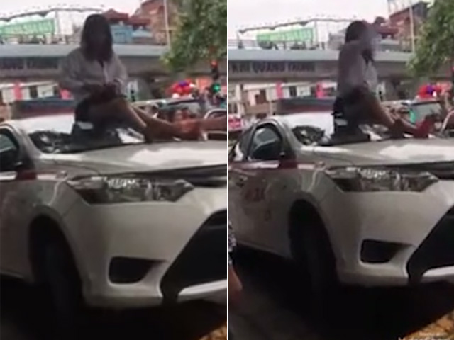 """Nữ tài xế taxi mặc váy leo nóc xe """"ăn vạ"""" CSGT"""