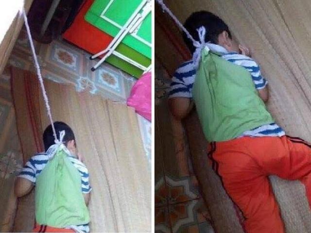 Xót xa hình ảnh bé trai 4 tuổi bị buộc dây vào cổ, nhốt trong lớp học
