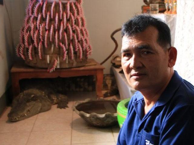 Người đàn ông không bao giờ phải khóa cửa nhà vì nuôi... cá sấu
