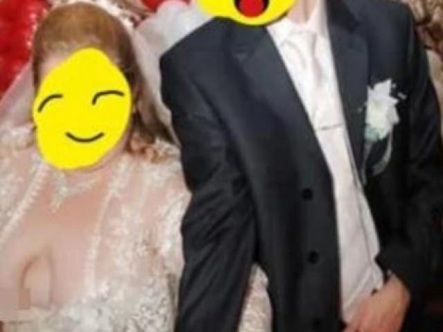 """Diện váy cưới mỏng tang nhưng không áo ngực, cô dâu """"lộ hàng"""" khi đang cắt bánh cưới"""