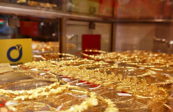 Giá vàng hôm nay 1/10: Dân buôn thờ ơ, vàng quay đầu giảm - 1