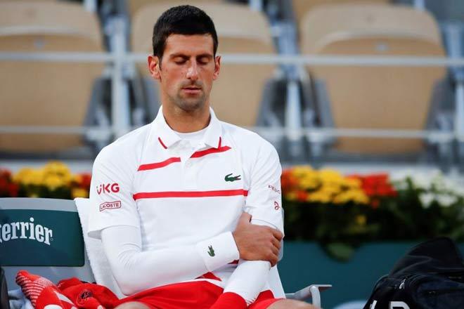Djokovic nén đau đạt cột mốc lịch sử, hẹn Nadal chung kết Roland Garros - 1