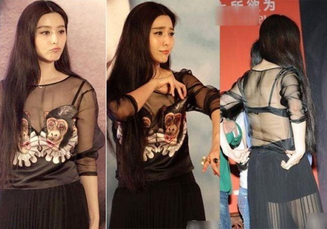 Không chỉ diện một thiết kế áo xuyên thấu lộ dấu vết nội y, Phạm Băng Băng còn tiện tay chỉnh lại dây áo ngay khi có sự cố. Đây quả thực là hành động khá xấu hổ.